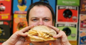 Andrew McMenamin  at his crisp sandwich shop, Simply Crispy, in Belfast. Photo: Niall Carson/PA Wire