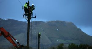 ESB worker Shane McGowan works on a telegraph pole in Drumcliffe, Co Sligo on Thursday. Photograph: Brian Lawless/PA Wire