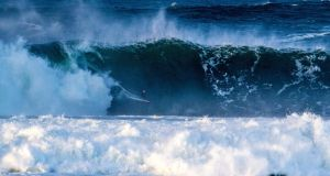 Professional surfer Andrew Cotton rides a large wave at Mullaghmore, Co Sligo. Photograph: Finn Mullen