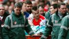 Arsenal's Mathieu Debuchy is stretchered off against Stoke. He has had surgery on a dislocated shoulder and will be out for three months. Photograph: Eddie Keogh/Reuters.