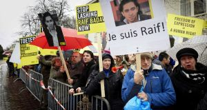 "Amnesty International staging a protest demanding the  release of Saudi blogger Raif Badawi in The Hague, the Netherlands. The Department of Foreign Affairs  said the ""nature and severity"" of the penalty   is a ""cause of concern"". Photograph: Martijn Beekman/EPA"