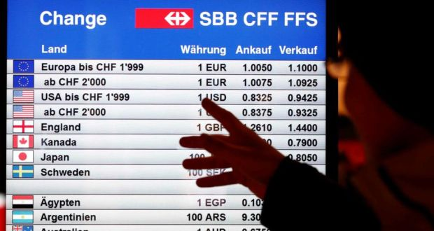A Man Looks At Board Showing Currency Exchange Rates In Bern