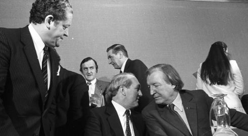 Charlie Haughey (right), talks with George Colley as Brian Lenihan looks on at a FF press conference in Dublin on January 15th, 1982 . In the background: Albert Reynolds (left), Sylvester Barren and Maire Geoghegan-Quinn (back to camera). Photograph: Pat Langan/The Irish Times