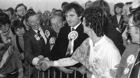 November 25th, 1983: Tom Leonard, the successful Fianna Fail candidate in the Dublin Central by-election, is congratulated by the Fine Gael candidate, Mary Banotti.  Between them stand Mr Haughey, and a young-looking Bertie Ahern, then Fianna Fail's director of elections.  Photograph: Paddy Whelan/The Irish Times