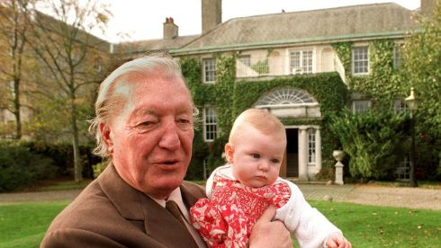 Mr Haughey, with his granddaughter Ciara outside Abbeville, the family home. Photograph: The Irish Times