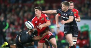 Munster's Ian Keatley passes the ball as Saracens' Owen Farrell moves in. The two sides meet again this weekend in the European Champions Cup. Photograph: INPHO/Billy Stickland