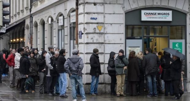 People line up at a currency exchange office in Geneva last Friday. 'One of the richest, most stable and economically successful countries in the world was forced to abandon policies it deemed to be in its best interests.' Photograph: Martial Trezzini/AP Photo/Keystone
