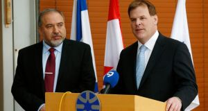 Israeli foreign minister Avigdor Lieberman and his Canadian counterpart in Jerusalem yesterday. Mr Baird's country voted against Palestinian membership of the ICC; his car was pelted with eggs by protesters in Ramallah. Photograph: Ronen Zvulun/Reuters