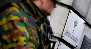 A Belgian soldier guards the entrance of the Jewish museum in central Brussels. Photograph: Yves Herman/Reuters