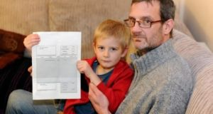 "Alex Nash with his father Derek: a brown envelope with a £15.95 (€20.80) ""no-show fee"" was put in   Alex's school bag. Photograph: Guardian/Apex/Lucy Davies"