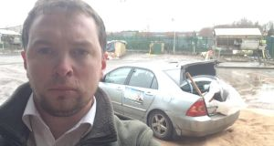 A selfie from cllr Paddy Meade with his car loaded with gritting salt in the background.