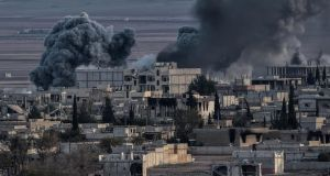 An airstrike from US-led coalition in the city of Kobani, Syria, in November. Islamic State laid siege to Kobani, in September.  The fighting continues with most residents having fled but the city is being defended by the People's Protection Units (YPG). Photograph: Aris Messinis/AFP/Getty Images