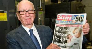 Rupert Murdoch of News Corporation said his view was that page three was   old fashioned but he said readers seem to disagree. Photograph: Getty