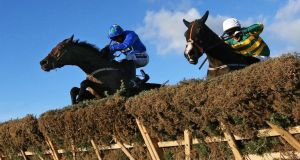 Ruby Walsh, left, on board Hurricane Fly clears the last hurdle ahead of Tony McCoy and Jezki during the Ryanair Hurdle at Leopardstown in December. Photograph: Cathal Noonan/Inpho