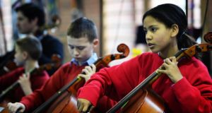 Salvina Praisetrichini (8) on cello, at the launch of Catholic Schools Week, at St Ultan's primary school, Cherry Orchard. Photograph: Eric Luke/The Irish Times