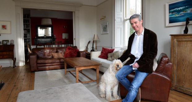 "Eoin O'Mahony at Rostellan in Greystones, with Jessie the dog. ""We'd rather move somewhere suitable now that will be the kids' home forever and that will still be manageable when we're in our 80s."" Photograph: Eric Luke / The Irish Times"
