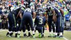 Quarterback Russell Wilson leads his Seattle Seahawks team-mates in prayer moments after providing a touchdown pass against Green Bay Packers in the second half of their NFC Championship Playoffs at CenturyLink Field in Seattle. Photograph: John G Mabanglo/EPA
