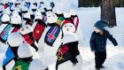 Walk on by: Snowmen representing countries worldwide during an exhibition from the NGO, action/2015, on the sideline of the 45th Annual Meeting of the World Economic Forum in Davos, Switzerland. Photograph: EPA