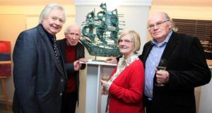 Artist John Behan (left) with  his sculpture 'Famine Ship Galway' and Eddie Linden, Eithne Vallely and  John Vallely at the opening of the London Irish Art 2015 exhibition in London last week.