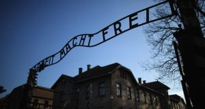 The infamous  inscription that reads 'Work Makes Free' at the main gate of the Auschwitz camp. Photograph:  Christopher Furlong/Getty Images