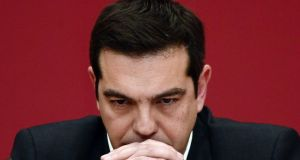 Syriza leader Alexis Tsipras: described as a warm, talkative and witty personality, who likes being around people. Photograph: Louisa Gouliamaki/AFP/Getty Images.