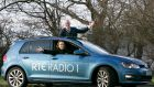 Ray D'Arcy and Jenny Kelly pictured in a branded car after Volkswagen signs on to sponsor 'The Ray D'Arcy Show' on RTÉ Radio 1.