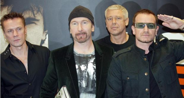 Rock band U2, whose guitarist The Edge (second left) learned to play on the instrument being auctioned. Photograph: Brenda Fitzsimmons