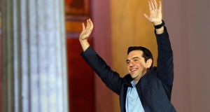 Head of Greece's Syriza party Alexis Tsipras waves to supporters after winning the elections in Athens. Photograph: Giorgos Moutafis/Reuters
