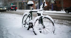 Snow collects on a bicycle during a snow storm in Cambridge, Massachusetts on January 24th.   Forecasters are warning of up to 90cms of snow for part of the east coast of the US on Monday.  Photograph: Reuters
