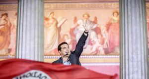 Alexis Tsipras, opposition leader and head of radical leftist Syriza party, greets supporters after his party's victory in the Greece general elections in Athens, Greece, 25th  January 2015. Photograph: EPA/MICHAEL KAPPELER