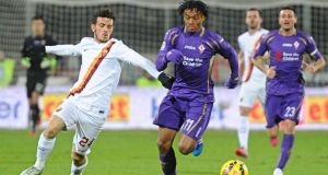 Fiorentina's Juan Cuadrado in action against AS Roma's Alessandro Florenzi during the Italian Serie A soccer match between AC Fiorentina and AS Roma. Photograph: Maurizio Degl' Innocenti