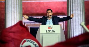 Alexis Tsipras,  leftist Syriza party, greets supporters after the initial results for the Greece general elections in Athens, Greece, 25th January 2015. Photograph: EPA/Orestis Panagiotou