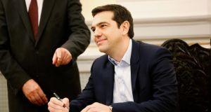 Alexis Tsipras, Greece's youngest prime minister in 150 years, broke with tradition for his swearing-in. Photograph: Yannis Behrakis/Reuters