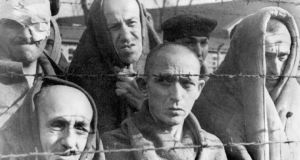 Survivors of the Auschwitz concentration camp are shown in a file photo from January 1945. Photograph: Reuters