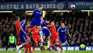 Chelsea's Branislav Ivanovic rises above the Liverpool defence to head home a goal in extra-time of the Capital One Cup semi-final at Stamford Bridge. Photograph:   Nick Potts/PA