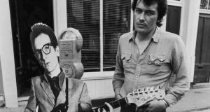Cut out for the music business: Jake Riviera with a cardboard Elvis Costello in 1977. Photograph: Getty Images