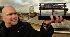 Sculptor Tim Schmalz displays a scale model of Homeless Jesus while visiting The Irish Times offices in Dublin last week. Photograph: Cyril Byrne