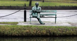 The statue of Patrick Kavanagh on the canal near Baggot Street bridge. The poet's A Christmas Childhood is among the 10 poems shortlisted in search for  Ireland's best loved poems of the past 100 years. Photograph: Eric Luke/The Irish Times
