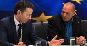 Eurogroup chief Jeroen Dijsselbloem (L) and Greek finance minister Yanis Varoufakis (R) speak during a press conference following a meeting at the Finance Ministry in Athens. Photograph: Simela Pantzartzi/EPA.