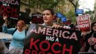 Activists protest near the Manhattan apartment of billionaire and Republican financier David Koch last June in New York City. The demonstrators were protesting against the campaign contributions by the billionaire Koch brothers. Photograph: Spencer Platt/Getty Images