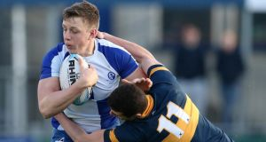 David Smith of King's Hospital tackles Jonny Guy of St Andrew's College during their  Leinster Schools Senior Cup first round match at Donnybrook. Photograph: Cathal Noonan/Inpho