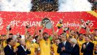 Australia's captain Mile Jedinak lifts the Asian Cup. (Photograph: Reuters/ Jason Reed)