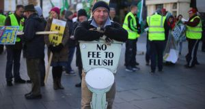 Anti-water charges protesters take part in a demonstration organised by the Cork Says No group through the centre of Cork city.  Photograph: Niall Carson/PA Wire