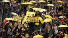 Protesters carrying yellow umbrellas, the symbol of the Occupy Central movement, march on a street in Hong Kong. Thousands of pro-democracy demonstrators took to the streets for the first major rally since the end of the Occupy campaign.  Photograph: Liau Chung-ren/Reuters