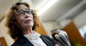 Junko Ishido, the mother of Kenji Goto, speaks to reporters at her home in Tokyo on Sunday  after  IS  announced in a video that it had killed her son.  Photograph: EPA