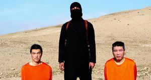 A file image taken from a previous  online video released by the Islamic State  shows ttwo Japanese hostages Kenji Goto (left) and Haruna Yukawa (right).