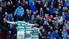 Celtic players celebrate Leigh Griffiths's goal in front of Rangers fans during their Scottish League Cup semi-final  at Hampden Park stadium. Photograph: Russell Cheyne