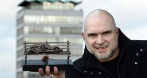 Tim Schmalz with his homeless Jesus Statue which is being gifted to Ireland by a benafactor. Photograph: Cyril Byrne/The Irish Times.