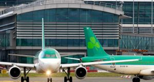 An Aer Lingus plane taxis before take off at Dublin airport. File Photograph: Cathal McNaughton/Reuters