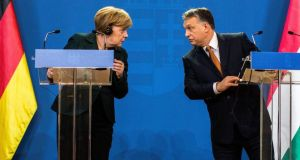 "German chancellor Angela Merkel  and Hungarian prime minister Viktor Orban in Budapest, Hungary: ""I'm firmly convinced that this conflict cannot be solved by military means,"" Dr Merkel said. Photograph: Carsten Koall/Getty Images"